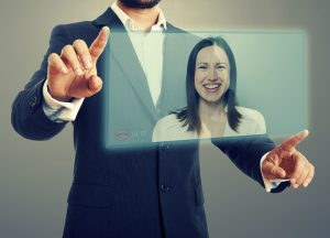 businessman and businesswoman communicating through video chat on virtual device. photo over dark background